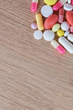 Multicoloured pills and capsules Royalty Free Stock Images