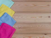 Multicoloured  rags for cleaning  on wooden table Royalty Free Stock Photo