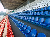 Multicoloured seats. Empty stadium stand waiting for crowd Stock Photo