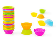 Multicoloured silicone baking cups. Pink, orange, green, blue and yellow silicone baking cups for muffins or cupcakes, on white background Royalty Free Stock Photos