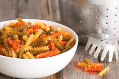Multicoloured spinach and tomato fusilli pasta Stock Photography