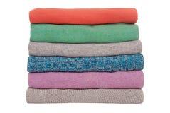 Multicoloured stapel van sweaters Stock Foto