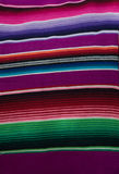 Multicoloured stripes. Bright stripe patterns on mexican rug Stock Photography