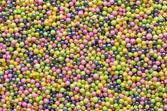 Multicoloured sweet sugar balls. Small ball pattern. Royalty Free Stock Image