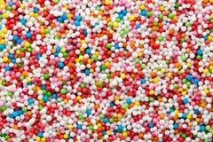 Multicoloured sweet sugar balls. Small ball pattern. Stock Image