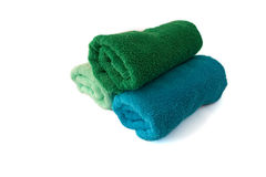 Multicoloured towels isolated on white. Blue, green and light green towels Stock Photo