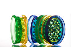 Multicoloured translucent grinders. For marijuana grinding Stock Images