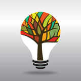Multicoloured Tree in Light Bulb Royalty Free Stock Image