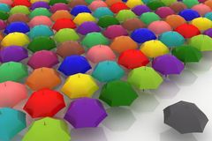 Multicoloured umbrellas are against one dark Royalty Free Stock Images