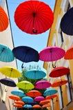 Multicoloured umbrellas over blue sky Stock Photo