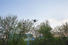 Multicopter is flying in blue sky Stock Photography