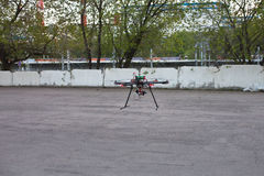 Multicopter is landing to the ground Stock Images