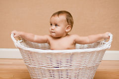 Multicultural baby in white basket Stock Photo