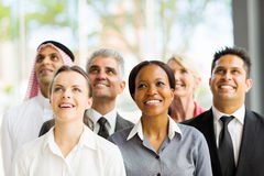 Multicultural business group. Cheerful multicultural business group looking up Stock Image