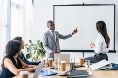 Multicultural business people having business meeting. In office royalty free stock photos
