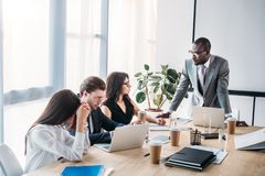 Multicultural business people having business meeting. In office stock image