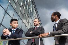 Multicultural business team meeting outdoors near office building successful. Businessmen concept royalty free stock image