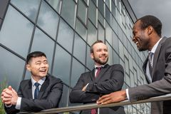 Multicultural business team meeting outdoors near office building successful. Businessmen concept royalty free stock photography