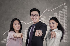 Multicultural business team pointing at camera Stock Photo