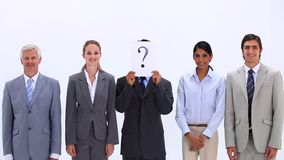 Multicultural business team with a question mark sign Royalty Free Stock Photos