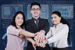 Multicultural businesspeople joined hands Stock Photos