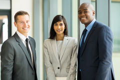 Multicultural businesspeople office. Group of multicultural businesspeople standing in modern office stock photos