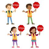 Multicultural children in crossing guard uniform Stock Images