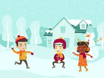 Multicultural children playing snowball fight. Royalty Free Stock Photo