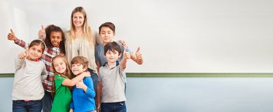 Multicultural children in school class of a primary school stock image