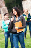 Multicultural College Students at Park Stock Image