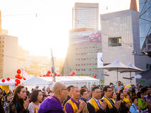 Multicultural crowd praying in Melbourne. Melbourne, Australia on May 15, 2016: A diverse crowd is celebrating Buddha`s Birthday at Federation square Stock Photography