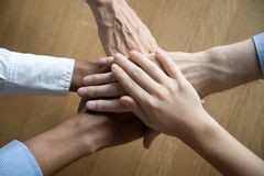 Free Multicultural Employees Stacking Hands Together Engaged In Team Building Stock Images - 144750014