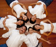 Multicultural Family Portrait. Multicultural American family photographed from above laying in a ring royalty free stock photos