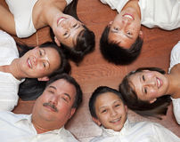 Multicultural Family Portrait. Multicultural American family photographed from above laying in a ring stock images