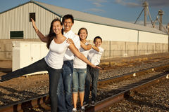 Multicultural Family Portrait. Teen children from a multicultural American family in an industrial setting featuring railroad tracks stock images