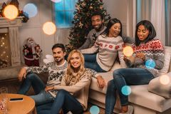 Multicultural friends on christmas eve stock images