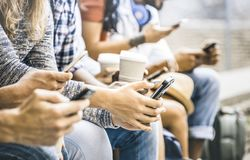 Multicultural friends group using smartphone with coffee cup. Multicultural friends group using smartphone with coffee at university college break - People hands royalty free stock image