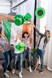 Multicultural friends throwing up green hats. On patricks day royalty free stock photos