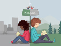 Multicultural girl and boy read mail Royalty Free Stock Image