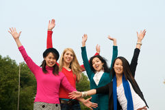 Multicultural girls in College Cheering stock photo