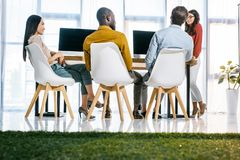multicultural group of business people having meeting at workplace stock photography