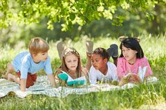 Multicultural group of children learn together stock photos