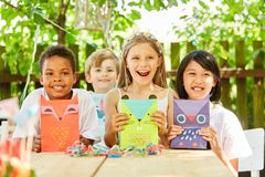 Group of kids with creative gift bags Stock Photos