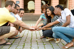 Multicultural group of people squatting together royalty free stock images