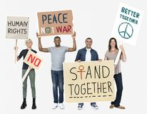 Multicultural group of people standing together stock images