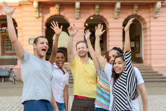 Multicultural group of people waving their hands royalty free stock photo