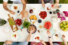 Multicultural group sharing food outside stock photos