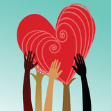 Multicultural hands holding heart Stock Photo