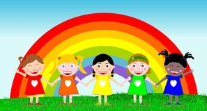 Multicultural Happy Kids Hand in Hand Outdoor. Five happy multicultural kids stand hand in hand in front of a big rainbow in the background Royalty Free Stock Photos