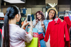 Multicultural hipster girls taking photo in boutique. Fashion shopping girls concept Stock Images